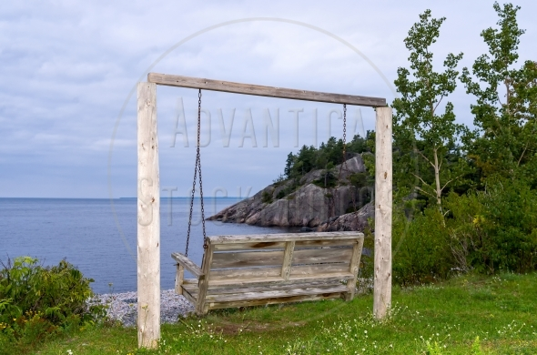 Wooden swing at a lakeside