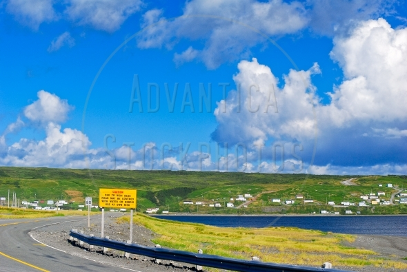 Road and a coastal village in Newfoundland