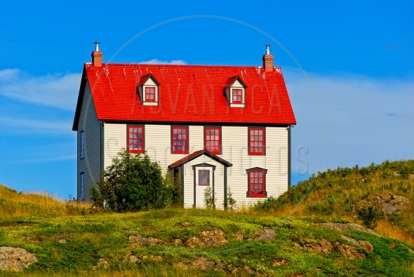 House with red roof on a hill