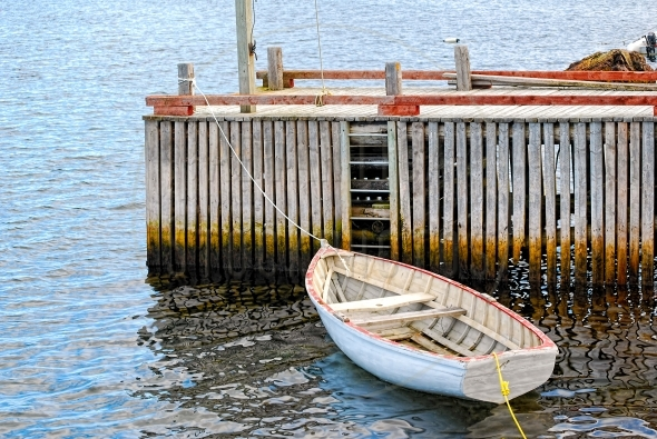 Wooden boat tied to a dock