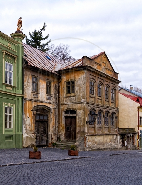 Old abandoned building on a cobblestone street
