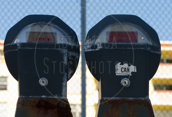 Two old rusty parking meters