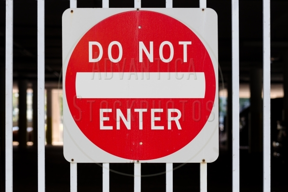 Do Not Enter Sign – on white steel bars