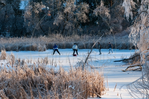 Playing pond hockey after an ice storm