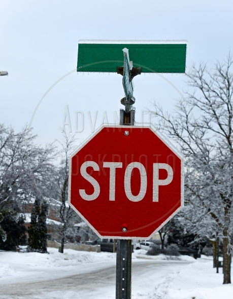 Stop sign encased in the ice after ice storm