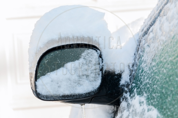 Ice and snow covered rearview mirror
