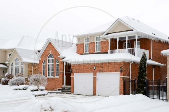 Large brick home in a winter setting
