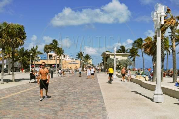 Tourists walking on Hollywood beach boardwalk