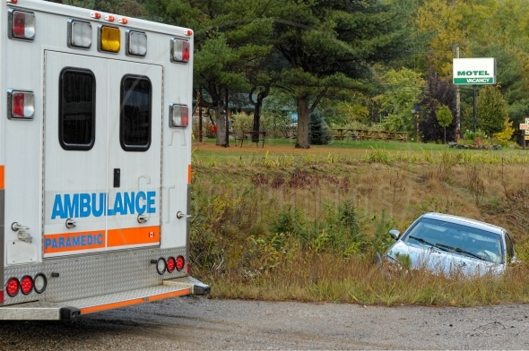 Car in the ditch and an ambulance truck