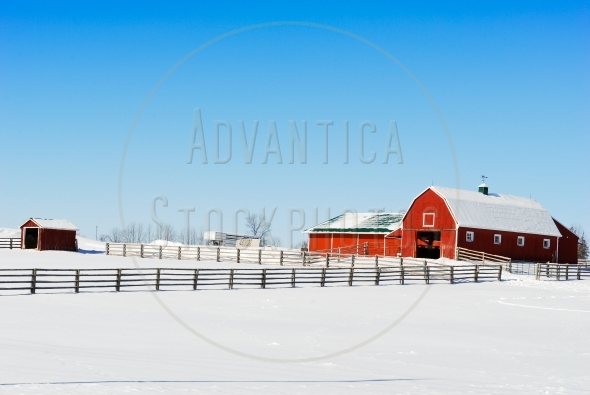 Red barn and fence in winter