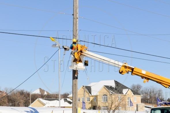 Electrician repairing power lines