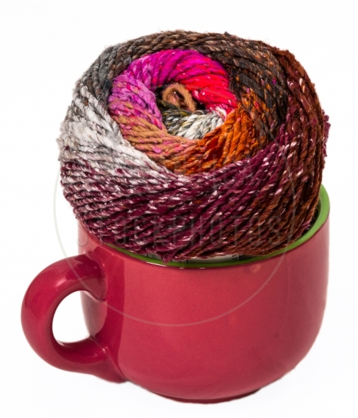 Colorful knitting yarn in a soup bowl