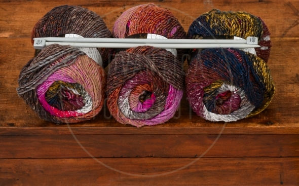 Three skeins of colorful knitting yarn