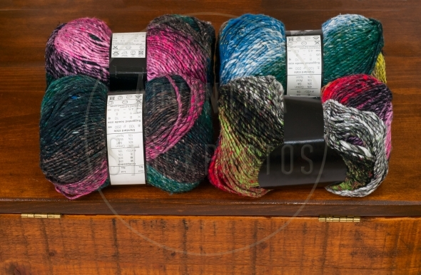 Four skeins of colorful knitting yarn